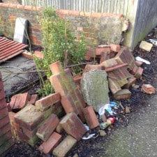 fence and brick wall damaged