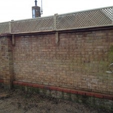 fence trellis installed on top of brick wall