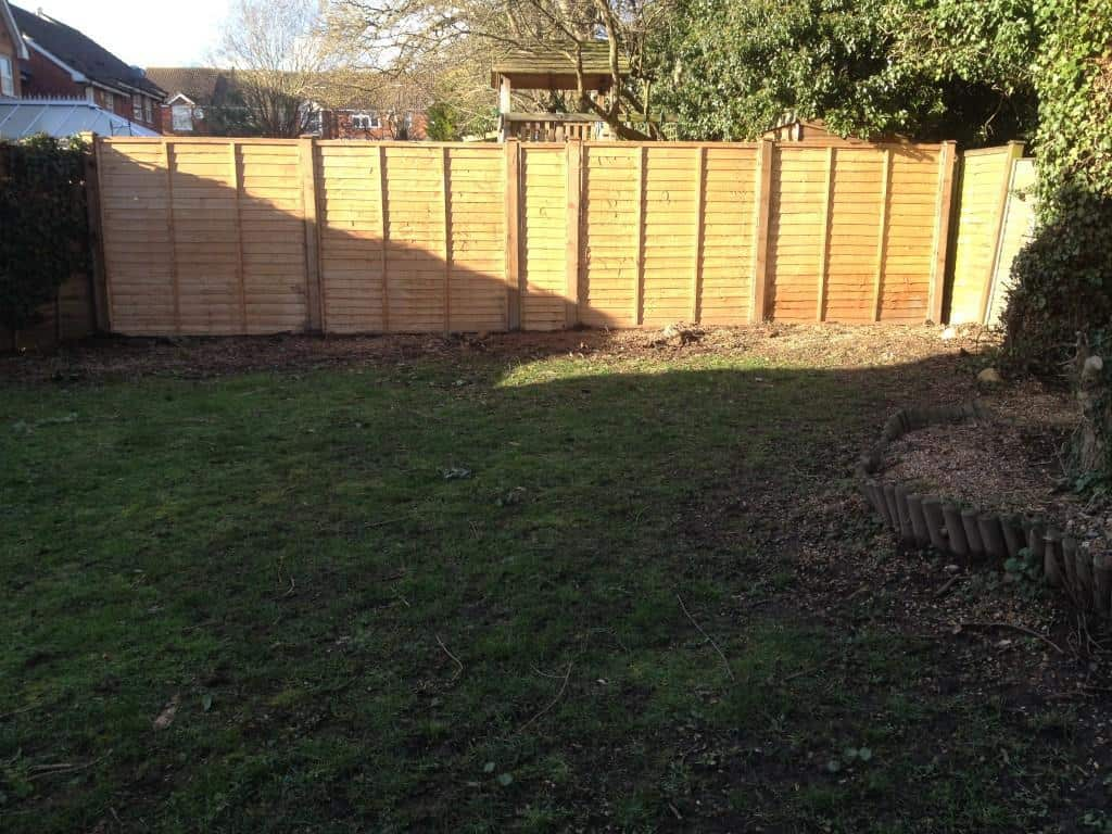 new wooden fence - fence posts and overlap panels