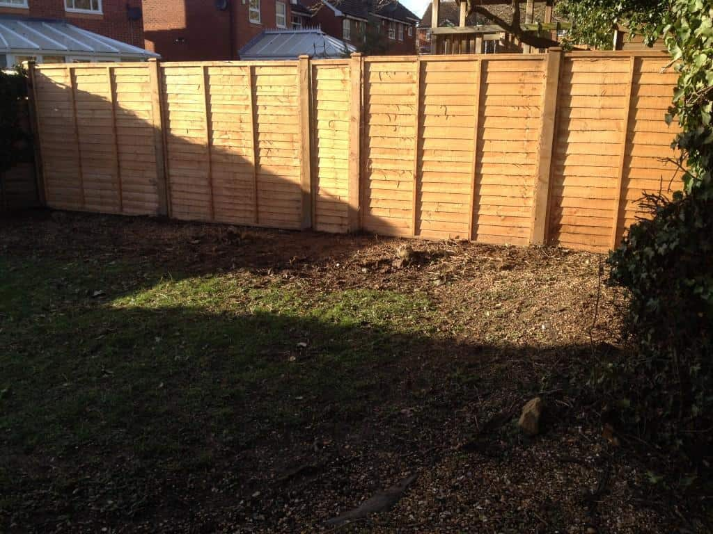 new wooden fence. wooden fence posts and overlap panels