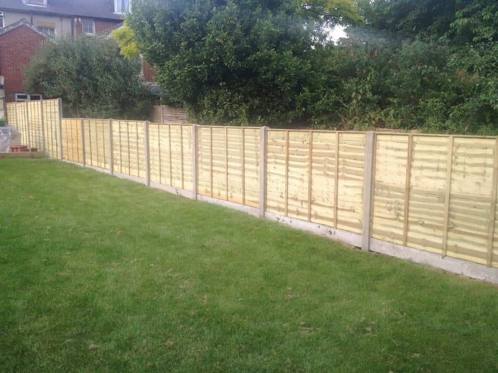 fence erection - concrete posts and concrete gravel boards with overlap panels