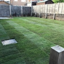 turfing, edging and concrete shed base construction
