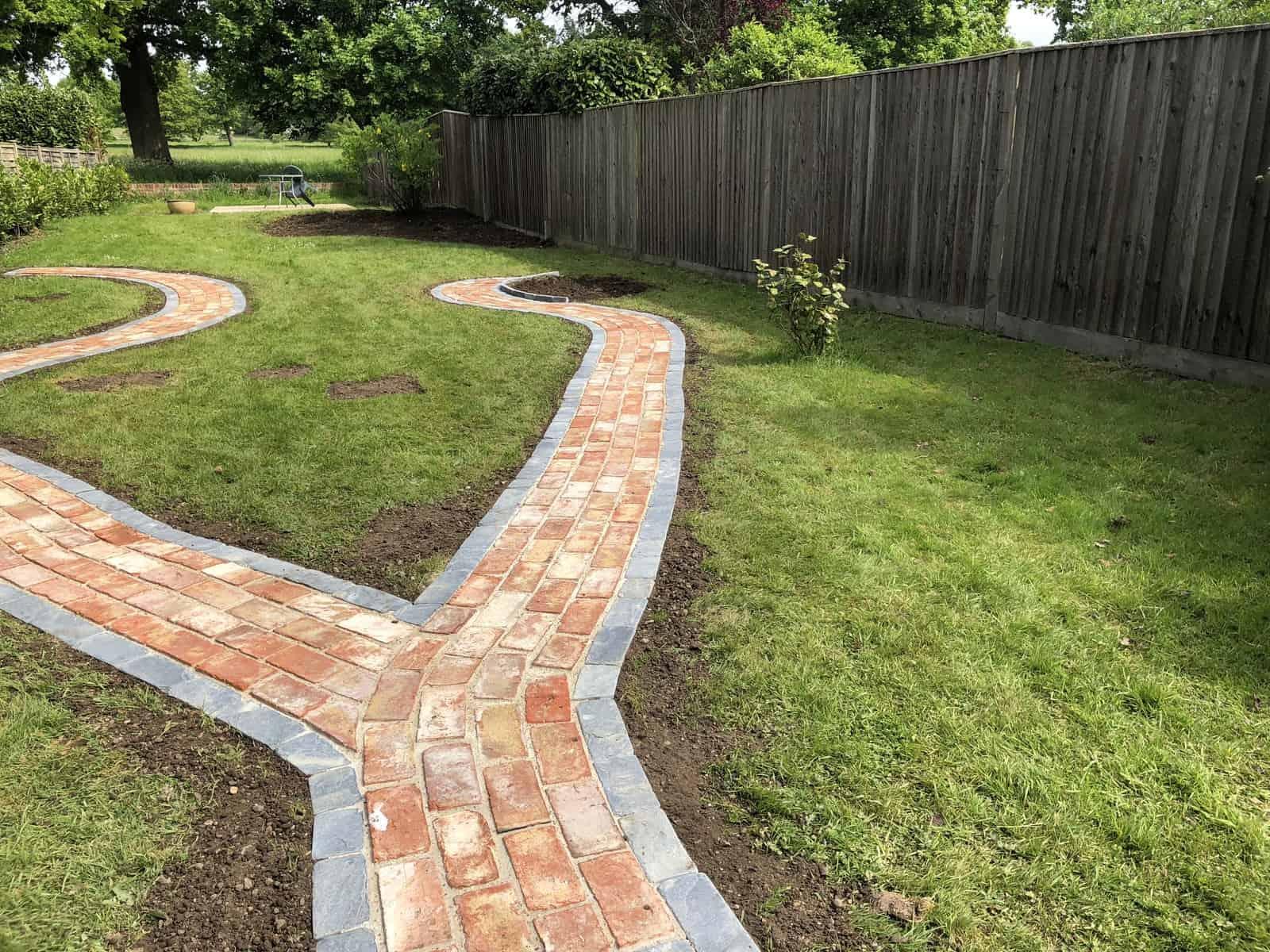 garden pathway made of slate edging stones and reclaimed bricks