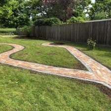 garden pathway made of slate edging stones and reclaimed bricks