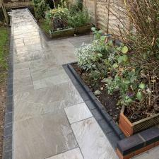 Landscaping. New sandstone patio and pathways laid.